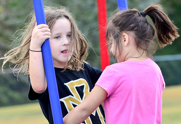 KEVIN HARVISON | Staff photo<br /> Pictured from left, Raven Williams and Layla Peasha, enjoy playing during a recent MPS visit to Chadick Park.