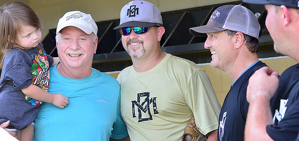 KEVIN HARVISON | Staff photo<br /> Second from left, former McAlster High School baseball coach Randy Hughes and current MHS Superintendent, has some laughs with former MHS baseball players, Sammy French, Clint Allford and Troy Meadows before the start of the 2019 Alumni Baseball game Saturday at MIke Deak Field.