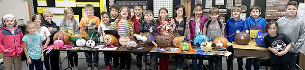 KEVIN HARVISON | Staff photo<br />  Christie Short's Emerson Second Grade Class posses for a pumpkin picture.  The class had to decorate a pumpkin from the character of a book.