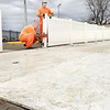 KEVIN HARVISON | Staff photo<br /> Inmates set the walls of the skate rink near the Farmers Market off of Main Street and Choctaw Avenue.