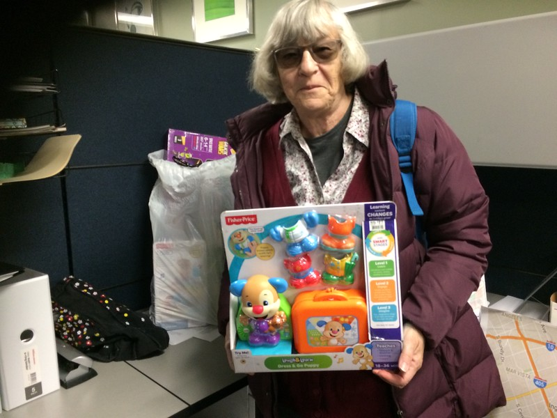 Librarian Kathy Russell donates annually to Project Santa Claus