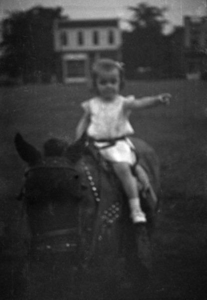 Girl on Donkey, Pointing