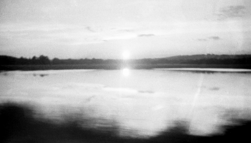 Traveling, Sun Reflected in Water