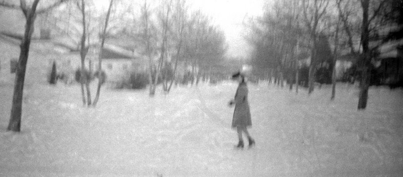 Woman on a Snowy Street