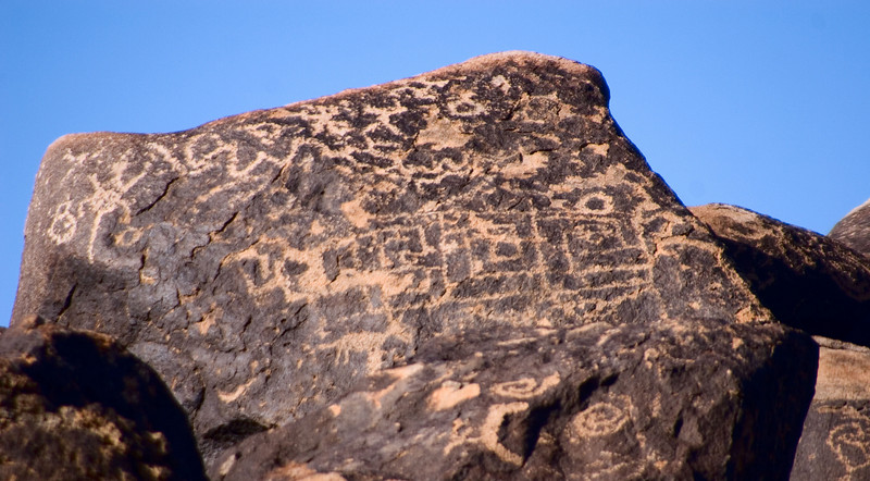 """Square Glyphs  <span class=""""gg_commentarty"""">The glyphs aren't really painted. They're chipped out. The rocks are covered with a darker layer, which the artists chipped away.</span>"""