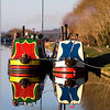 Ready to make way. Colourful Canal boats reflected in the Gloucester Sharpness Canal by Jeff Arthur