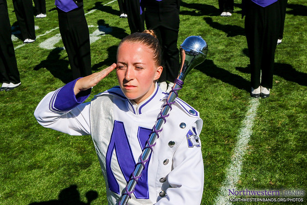 Drum Major Emily Liquin Salutes