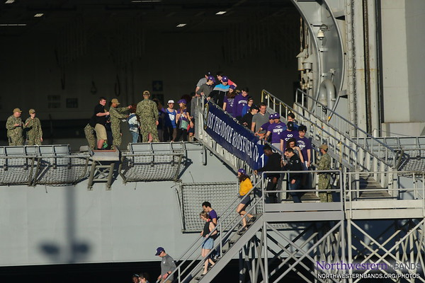 Still Wide-Eyed, the @NorthwesternU Band Disembarks @TheRealCVN71