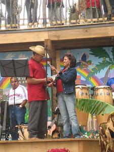 Julia presents an award to Heriberto Santiago