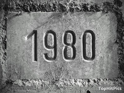 "The Number ""1980"" Carved Into A Wall in Cuna, Italy"