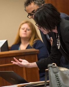 Maryellen Albanese, a special prosecutor from the Orange County District Attorney's Office, reads notes that were pulled from Gilberto Nunez's phone as defense attorney Evan Lipton reads over her shoulder during the pretrial hearing for the Gilberto Nunez trial at the Ulster County Courthouse in the City of Kingston, NY on Wednesday, May 11th, 2016. KELLY MARSH/For the Times Herald-Record
