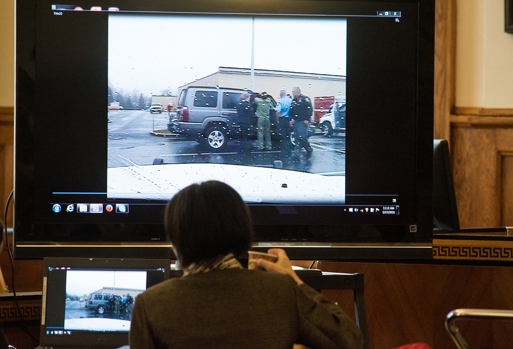 . Maryellen Albanese, a special prosecutor from the Orange County District Attorney\'s Office shows video footage of Gilberto Nunez, center, consoling Linda Kolman in an SUV at the Planet Fitness as seen from Ryan Watt, a former Town of Ulster police officer\'s vehicle during the murder trial of Gilbero Nunez at the Ulster County Courthouse in the City of Kingston, NY on Friday, May 27th, 2016. KELLY MARSH/For the Times Herald-Record