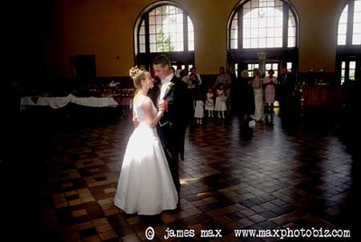 The couple went out for their first dance and they walked into the only beam of light coming in from the windows high above.  When I saw where they had begun to dance I got pretty excited and you can see why here.