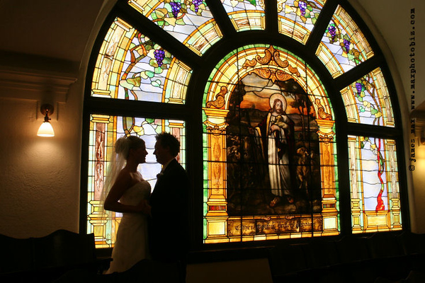 We did not have to go far to find a beautiful setting for this bride and groom image.  They almost look like they are a part of the stained glass.