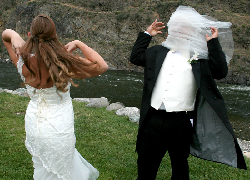 This image was a big surprise for all of us... Not least of all the groom who caught his brides veil.  The wind in this canyon is pretty strong and it just whipped that right off of her hair and onto his face.