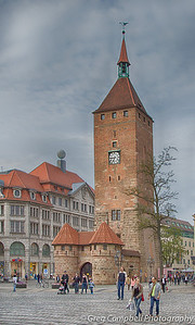 Some clock tower. German beer is likely served either in this structure, or within a few short meters of it.