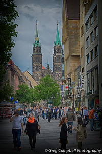 """""""At the End of the Street"""" - a bunch of people hunting for dinner in Nuremberg. There's nothing very good to eat here; people seem to wander around from 6pm until 8pm every night looking for new places which just opened, can't find any, and then go home hungry. What I imagine the zombie apocalypse will be like."""