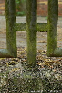 A fence structure on the left of the entrance portal in the previous image.