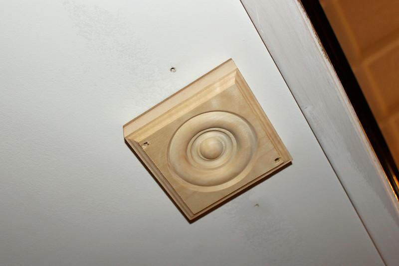 Rosette block for balcony rod end inspection cap