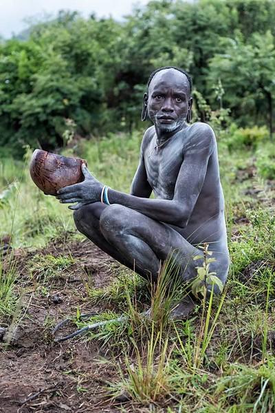Nyangatom Man With Gourd of Blood