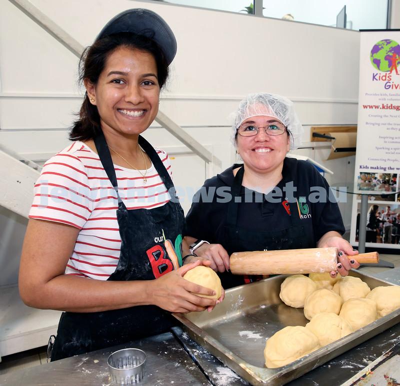 Volunteers at OBK make food packs for the French Embassy. Patsy Dsouza & Landi Feller.