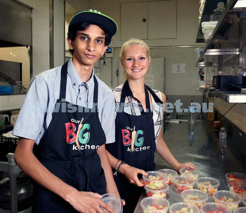 Volunteers at OBK make food packs for the French Embassy. Rohan Patel & Isabel de Groot.