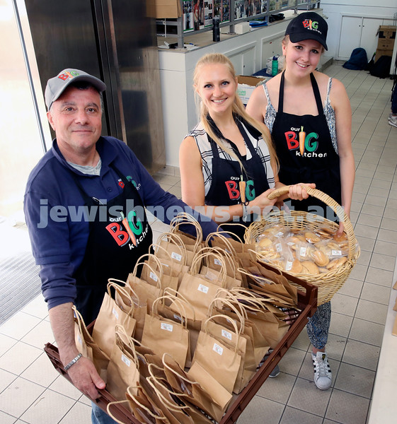 Volunteers at OBK make food packs for the French Embassy. George Karounis ,Isabel de Groot, Nathalie Nossek with a crate load of packages.