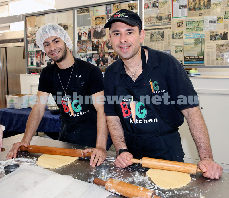 Volunteers at OBK make food packs for the French Embassy. Sam Mahdiya & Danny Moss roll dough.