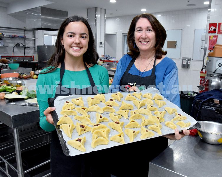 OBK Hamantashen Bake. Chana Slavin (left), Ruth Kellerman about to place a tray of hamantashen into the oven. Pic Noel Kessel