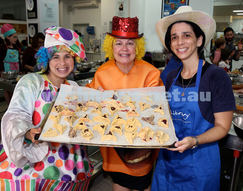 Jems, PJ Library & OBK Purim party at OBK. (from left)  Rivky Shuchat, Laya Slavin, Justine Saidman with a tray of hamantashen. Pic Noel Kessel