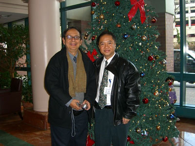 Saya Thaneoke Kyaw-Myint & Peter , Roosevelt Island NYC Dec 7, 2005 photo credit: peter