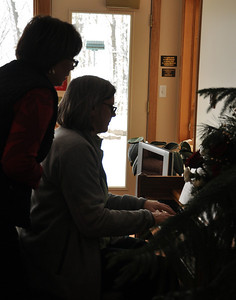 Eileen playing piano and Josie singing  Dec 4, 2011  Omega House