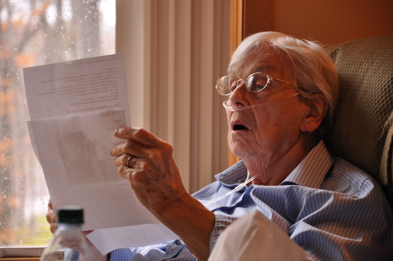 Mom looking at photos of Great Grandchild Sarina Noell O'Brien