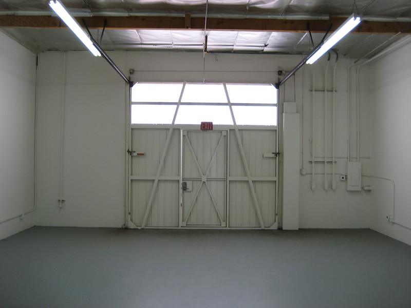 Clean Warehouse space, wide enough to fit 3 rows of racks.