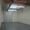 Brand new warehouse space with grey painted floors and new truck door.