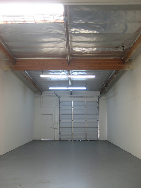 Warehouse space.  Grey painted floor and new truck door.