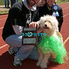 OCEAN CITY, NJ - APRIL 07:  Lucia, 7 year old Golden Doodle, winner of Best In Show with owners attends the Woof N Paws event on April 7, 2012 in Ocean City, New Jersey.