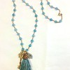 7-TAS-KEY CO125  BLUE SILK TASSEL WITH BRONZE KEY AND BEAD CAP ON GOLD HEISHI AND BLUE QTZ