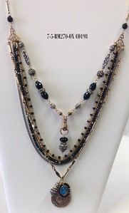 7-5-RM270-OX CO198  ST ANTHONY, RHINESTONES AND BLUE ENAMEL VINTAGE MEDAL W/ ONYX ON 5 STRANDS ONYX AND CHAIN WITH TOP STRAND FEATURING HAND HOLDING ONYX/RHINESTONE PENDANT