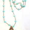 7-HAND-AZ CO110  HAND HOLDING CROSS, FEATHER AND AQUA CHALCEDONY PENDANT ON GOLD HEISHI AND AMAZONITE