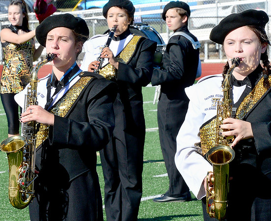 Kevin Harvison | Staff photo<br /> Members of the Talihina Golden Tigers High School Marching Band perform Wednesday during the OSSAA Southeastern Regional Band competition at Hook Eales Stadium.