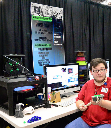 Kevin Harvison | Staff photo<br /> Derrick Aaron explains some of the benefits from his Kiamichi Technology Center Environment and Spatial Technology class during a career fair at the Southeast Expo.