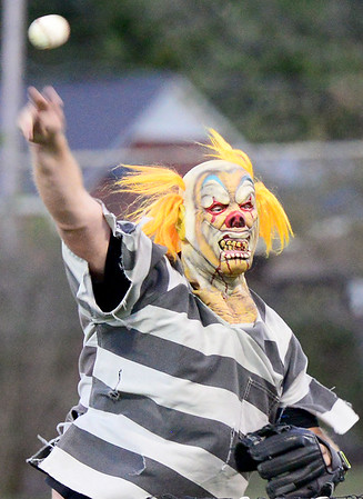 Kevin Harvison   Staff photo<br /> McAlester Assistant Baseball Coach A.J. Mason delivers a pitch during McAlester High School baseball's first ever Halloweenscream Baseball crazy costume game at Mike Deak Field.