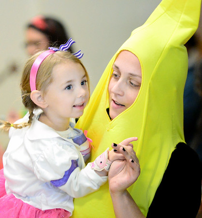 Kevin Harvison | Staff photo<br /> Pictured from left, Keelie Klembarra a student at Washington Early Childhood/Kibios Head Start Center and school aid Gail Jewell dance during a Halloween celebration at the center's dance Tuesday.