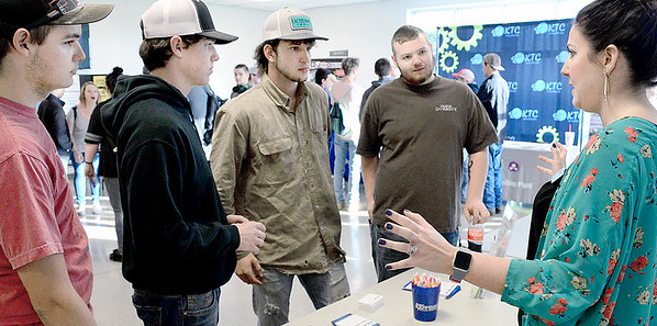 Kevin Harvison | Staff photo<br /> At right,Express Employment Professionals, Elizabeth Heflin, business develope manager, speaks with Kiamichi Technology students about employment opportunities during KTC's Manafacturing Day.