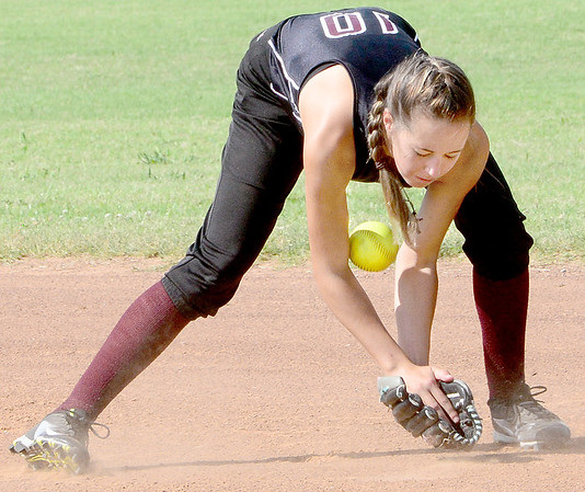 Kevin Harvison | Staff photo<br /> Krebs shortstop Emalee Rodgers stops a ball during Organization of Rural Elementary Schools 2017 State Fastpitch Softball Tournament Division II against Brushy at the Pittsburg County Softball Complex Friday.