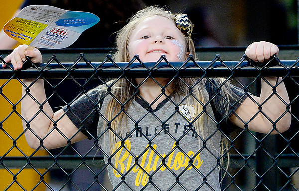 Kevin Harvison | Staff photo<br /> McAlester Buffalo fan Presley Gleese peeks over the fence to get a better view during a recent McAlester home football game.
