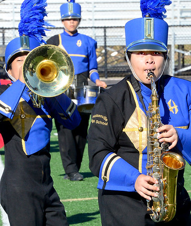 Kevin Harvison | Staff photo<br /> Members of the Holdenville High School Marching Band perform Wednesday during the OSSAA Southeastern Regional Band competition at Hook Eales Stadium.