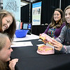 Kevin Harvison | Staff photo<br /> Pictured from left, Antlers students Desiree Yerta and Hannah Powers look at a Meth Mouth display from The Oaks Rehabilitative Services Center as The Oaks employees Brooke Mason and Angie Hearod visit with the students during the Career Fair at the Southeast Expo Thursday.