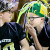 "Kevin Harvison | Staff photo <br /> Will Rogers student Jackson Heathcock, right, has a good time showing off his hat during ""funny hat"" day at the school."